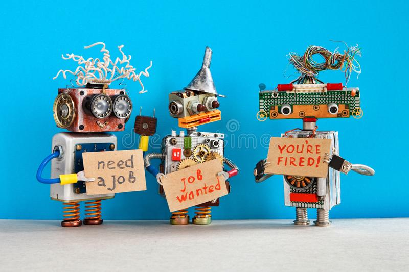 Automated dismissal and hiring of staff. The relationship between employer and employee. robot boss dismisses personnel. And shows cardboard You are fired. Two royalty free stock images