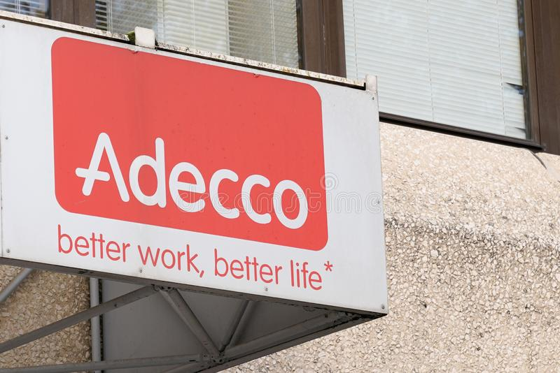 Bordeaux , Aquitaine / France - 11 25 2019 : Adecco sign logo shop building facade Temporary work agency company office store stock image
