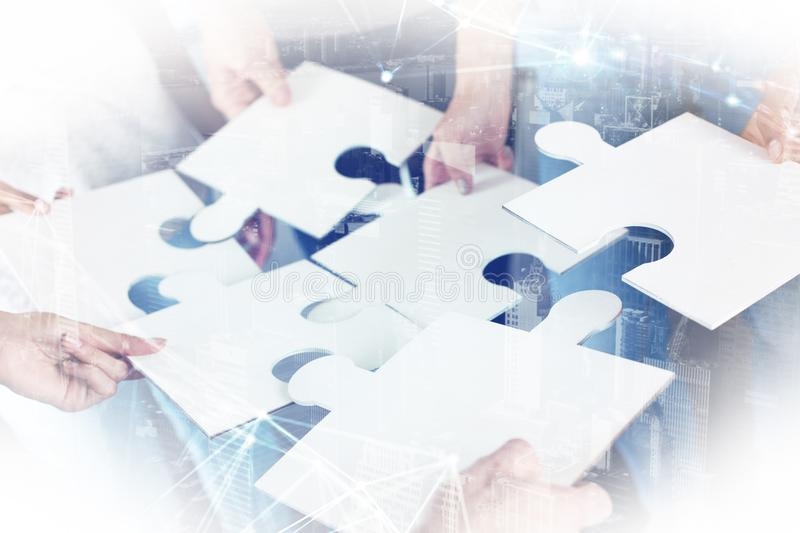 Team of businessmen work together for one goal. Concept of unity and partnership. Double exposure photo of a team that connects pieces of puzzle royalty free stock image
