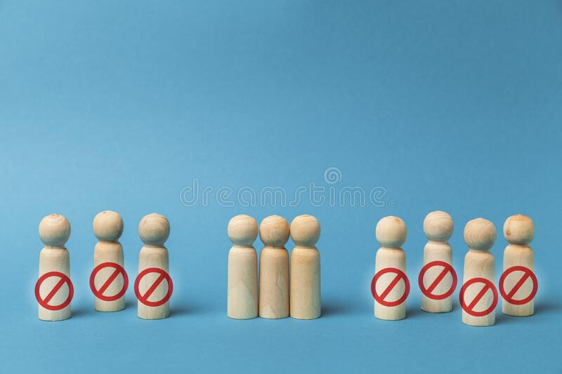 Figures of people on blue background, dismissal of employees in crisis. Problem of staff reduction.  royalty free stock photo