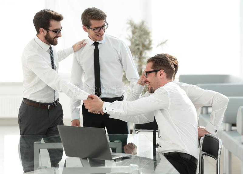 Handshake business colleagues in the workplace royalty free stock images