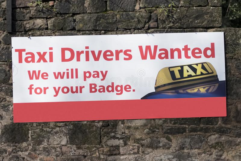 Taxi Drivers Wanted Job Employment Opportunities Sign On Wall Uber royalty free stock image