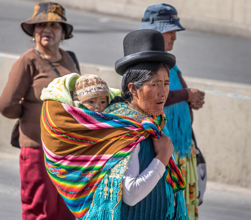 Traditional Woman Cholita in Typical Clothes with baby on her back during 1st of May Labor Day Parade - La Paz, Bolivia royalty free stock photo